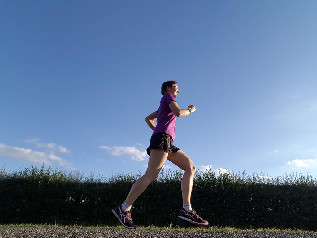 Woman running in the sunshine